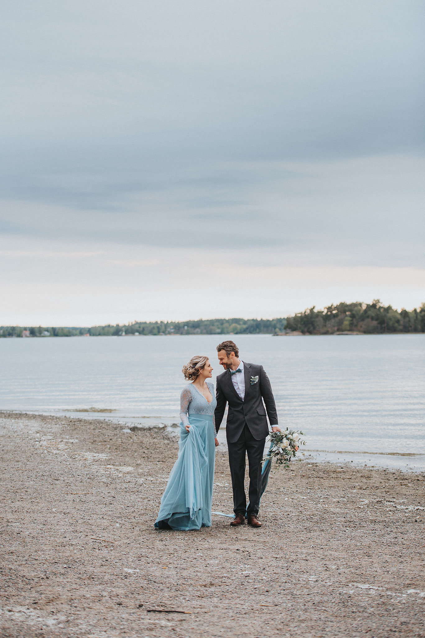 Stormy Scandinavian Wedding Inspiration Featuring a Dramatic Blue Gown | Snowflake Photo 21