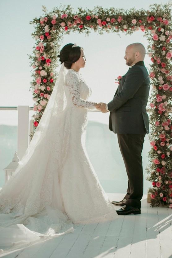 Intimate & Luxurious Cliffside Santorini Wedding | Stella and Moscha | Nikos Gogas 12