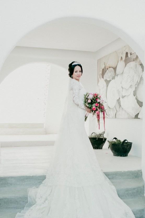 Intimate & Luxurious Cliffside Santorini Wedding | Stella and Moscha | Nikos Gogas 13