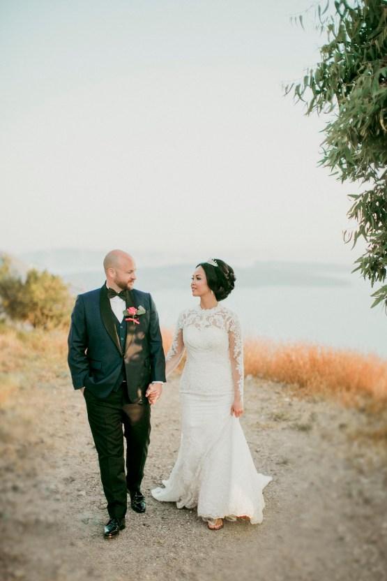 Intimate & Luxurious Cliffside Santorini Wedding | Stella and Moscha | Nikos Gogas 17