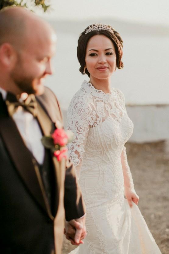 Intimate & Luxurious Cliffside Santorini Wedding | Stella and Moscha | Nikos Gogas 18