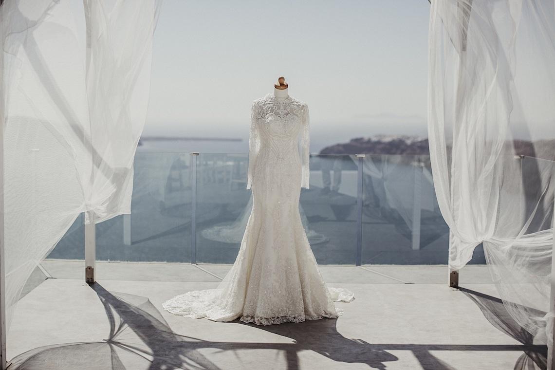 Intimate & Luxurious Cliffside Santorini Wedding | Stella and Moscha | Nikos Gogas 36