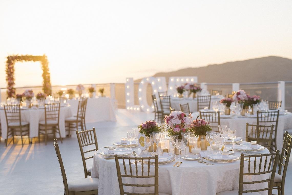 Intimate & Luxurious Cliffside Santorini Wedding | Stella and Moscha | Nikos Gogas 56