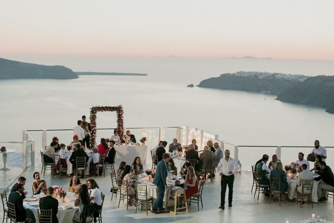 Intimate & Luxurious Cliffside Santorini Wedding | Stella and Moscha | Nikos Gogas 57