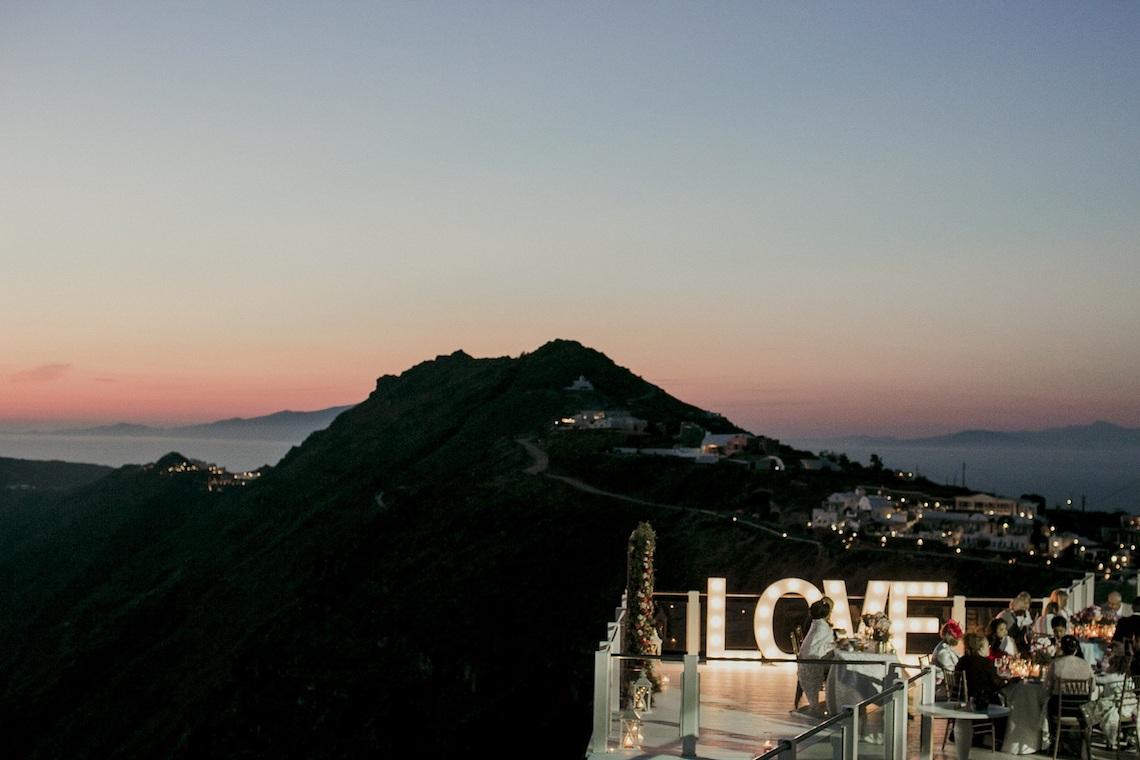 Intimate & Luxurious Cliffside Santorini Wedding | Stella and Moscha | Nikos Gogas 58