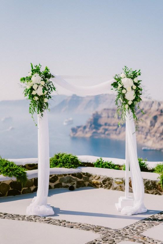 Classy Santorini Destination Wedding (With Amazing Caldera Views!) | Elias Kordelakos 11