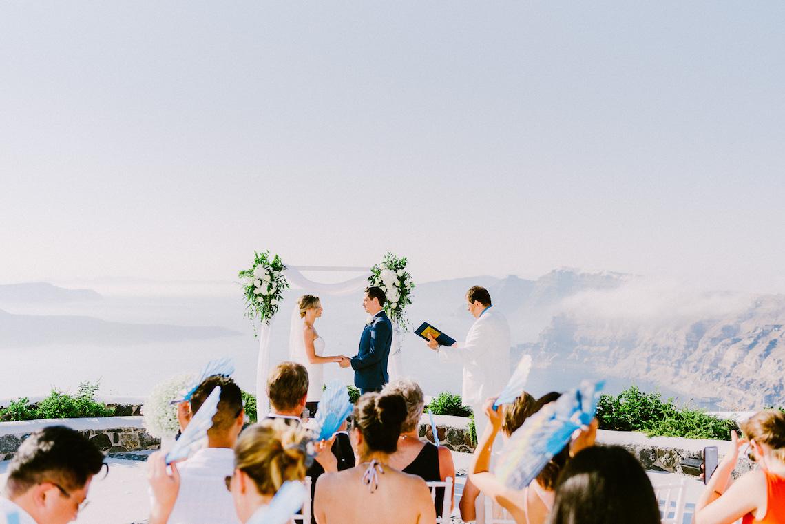 Classy Santorini Destination Wedding (With Amazing Caldera Views!) | Elias Kordelakos 41