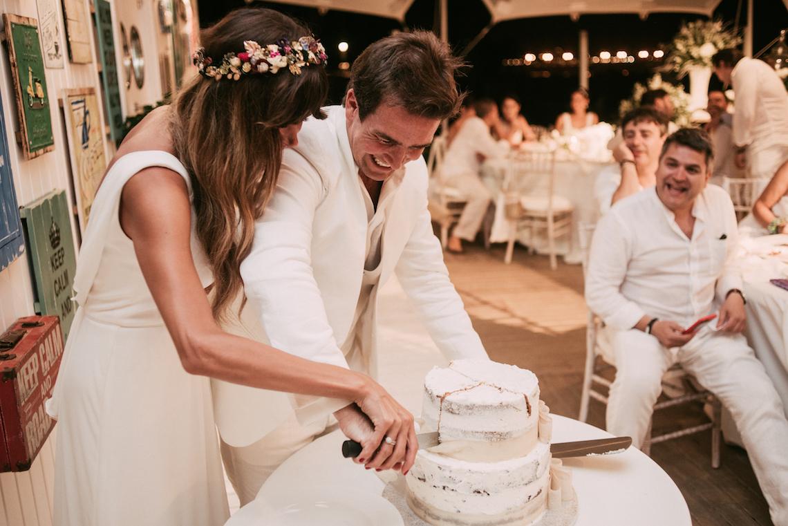 Relaxed All-White Spanish Beach Wedding With Seriously Glamorous Bridal Beauty Style   Sara Lobla Photography 18
