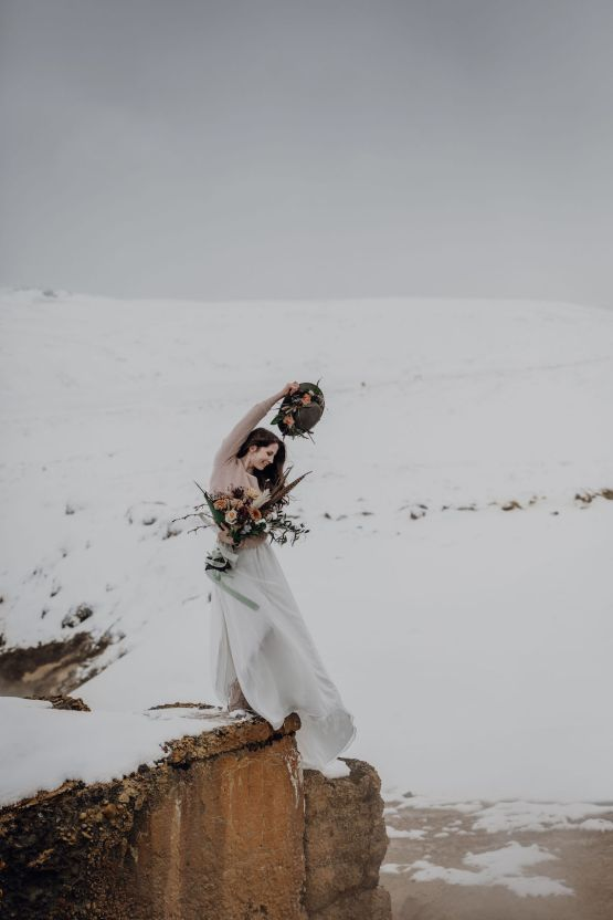 Wild Winter Wedding Inspiration from Iceland – Snowy Scenery and a Bridal Sweater – Melanie Munoz Photography 34