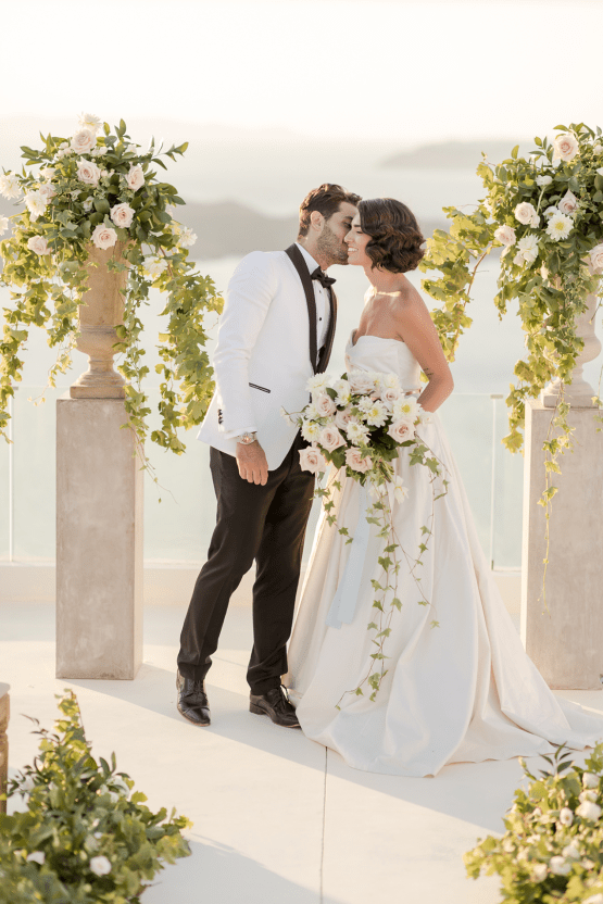 Pale Blue Greek Micro Wedding on the Cliffs of Santorini – Kimonas Photography 26
