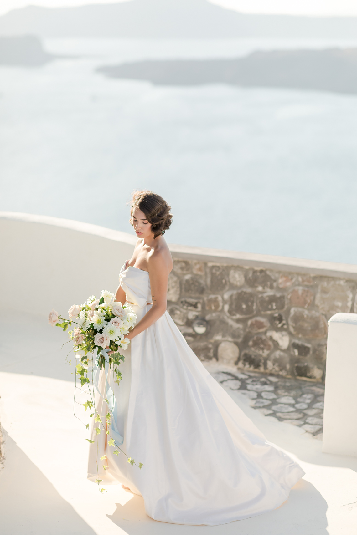 Pale Blue Greek Micro Wedding on the Cliffs of Santorini – Kimonas Photography 29