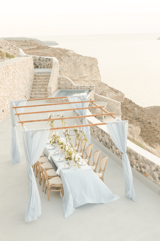 Pale Blue Greek Micro Wedding on the Cliffs of Santorini – Kimonas Photography 40