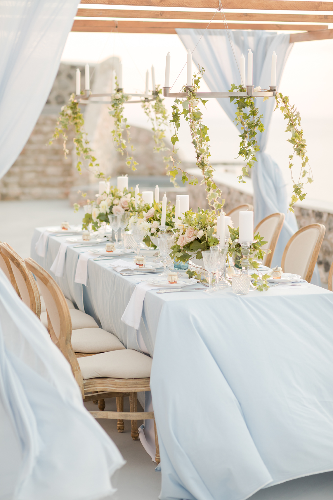 Pale Blue Greek Micro Wedding on the Cliffs of Santorini – Kimonas Photography 42