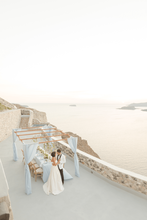Pale Blue Greek Micro Wedding on the Cliffs of Santorini – Kimonas Photography 52