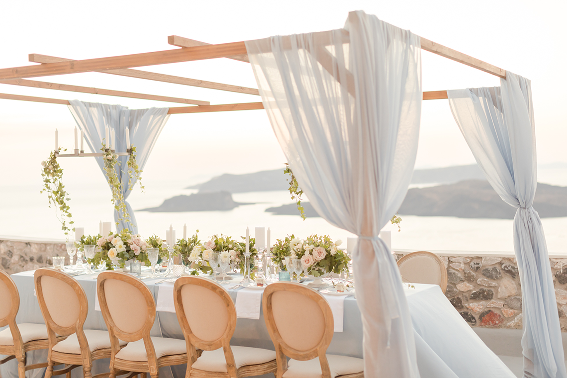 Pale Blue Greek Micro Wedding on the Cliffs of Santorini – Kimonas Photography 65